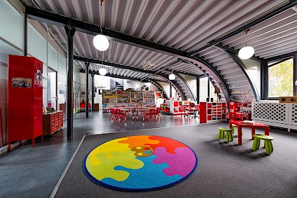 The Picasso group room in the bright, spacious attic with its red accents