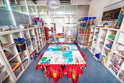 The art room packed with colors, paper and many different materials to be used for great ideas