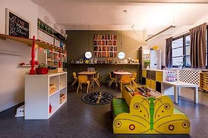 The Einstein room in soft light with the small yellow island and the toy store in the foreground